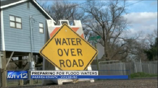 Water over road sign_121724