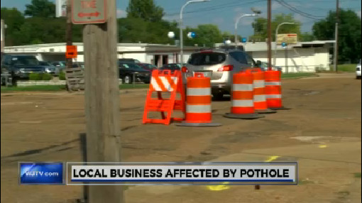 local-business-affected-by-pothole_213391