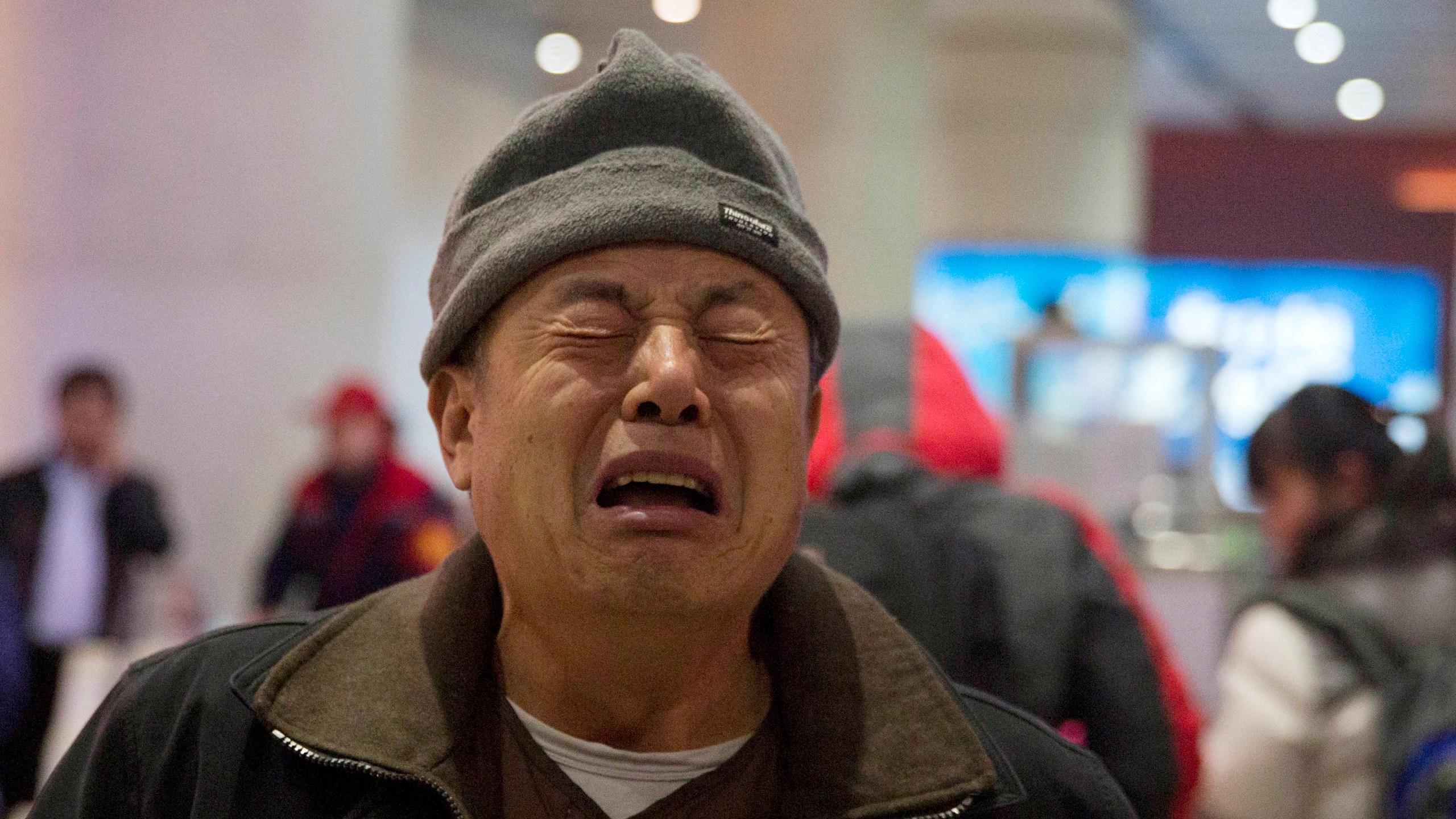 China Missing Plane Relatives Photo by Ng Han Guan, AP Photo_266597