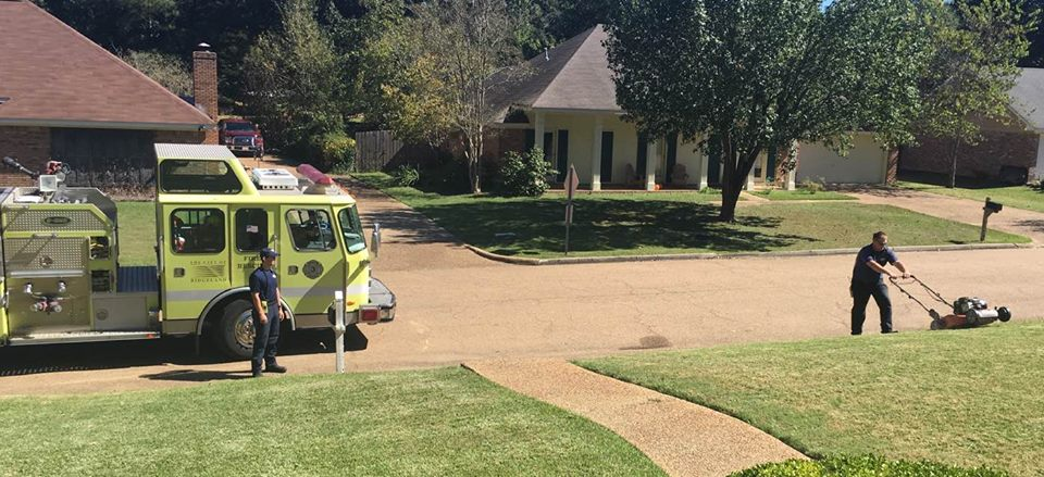 firefighters mow lawn after responding to medical call_441338